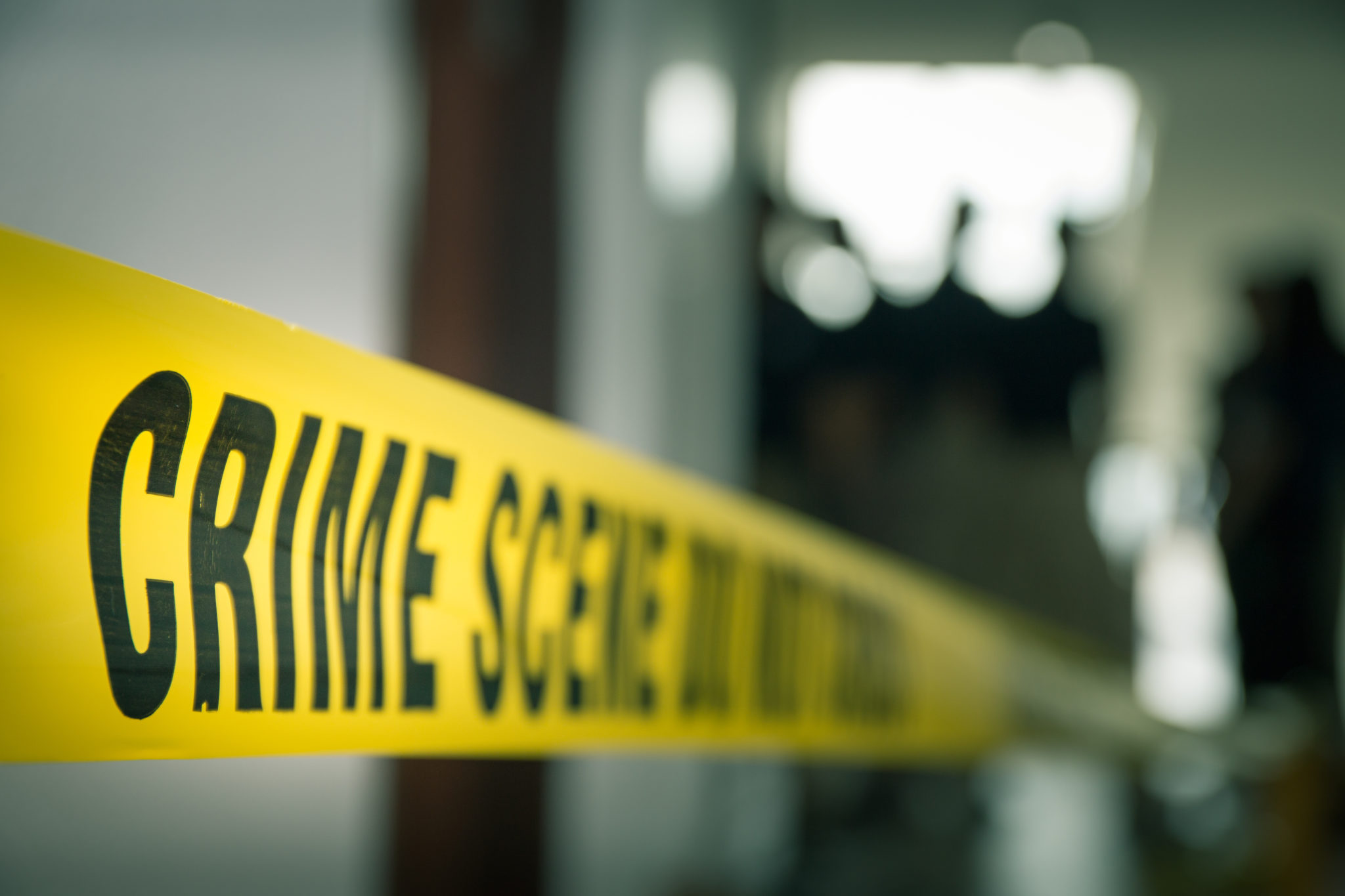 Crime,Concept,By,Police,Line,Tape,With,Blurred,Forensic,Law