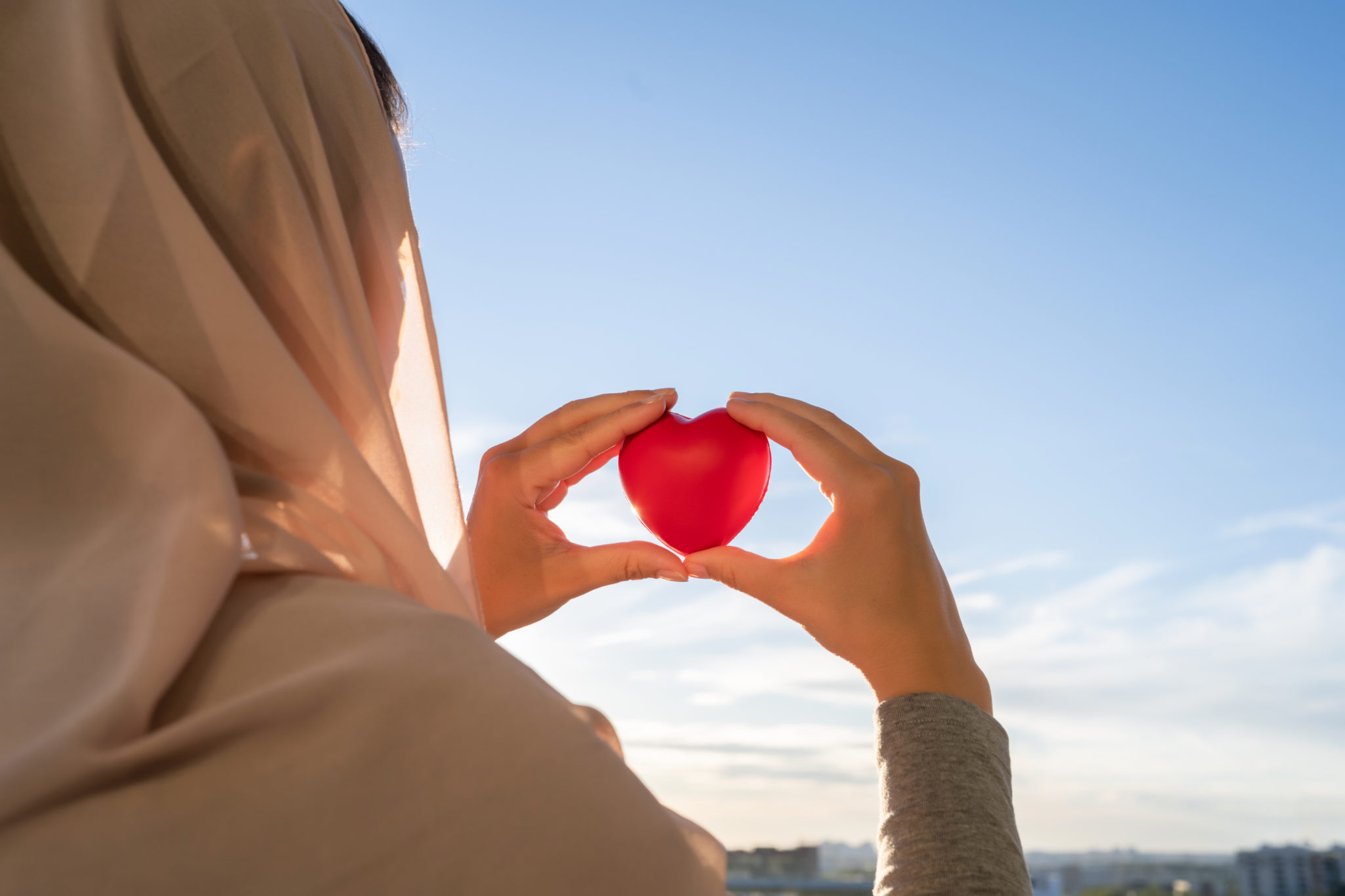 Silhouette,Of,Muslim,Woman,In,Head,Scarf,With,Red,Heart